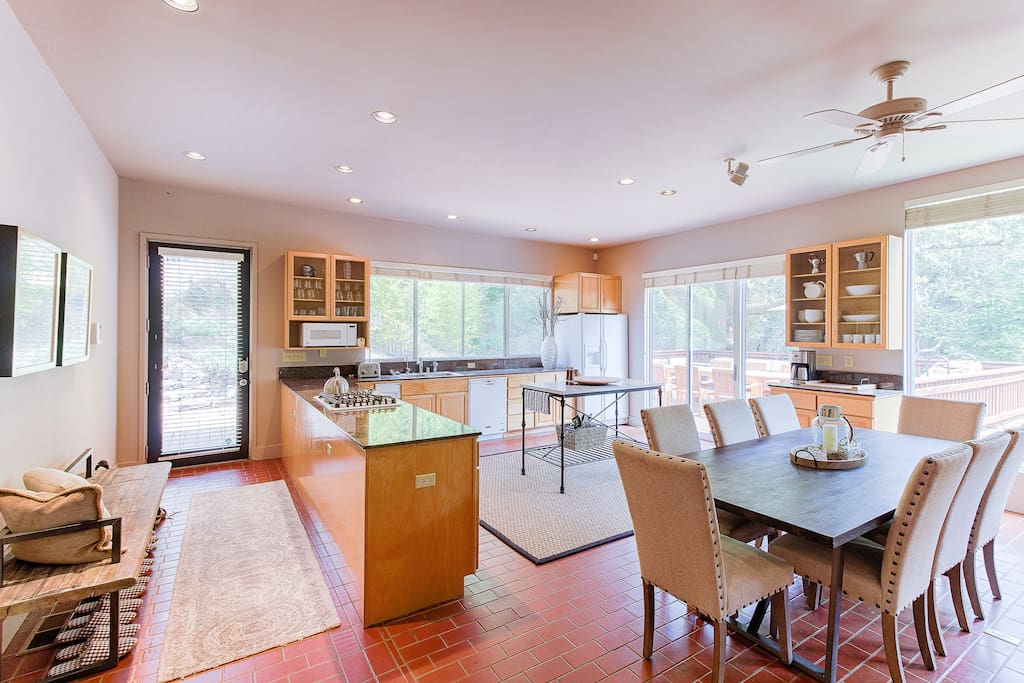 Serve up your delicious meals at the spacious, rustic dining table with room for eight. Sliding glass doors lead out to the wrap-around deck.