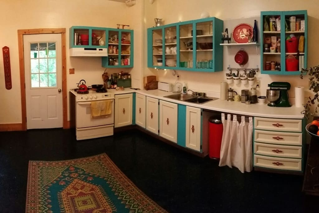 Kitchen with lots of space for cooking and chatting. The back door opens onto the back porch.