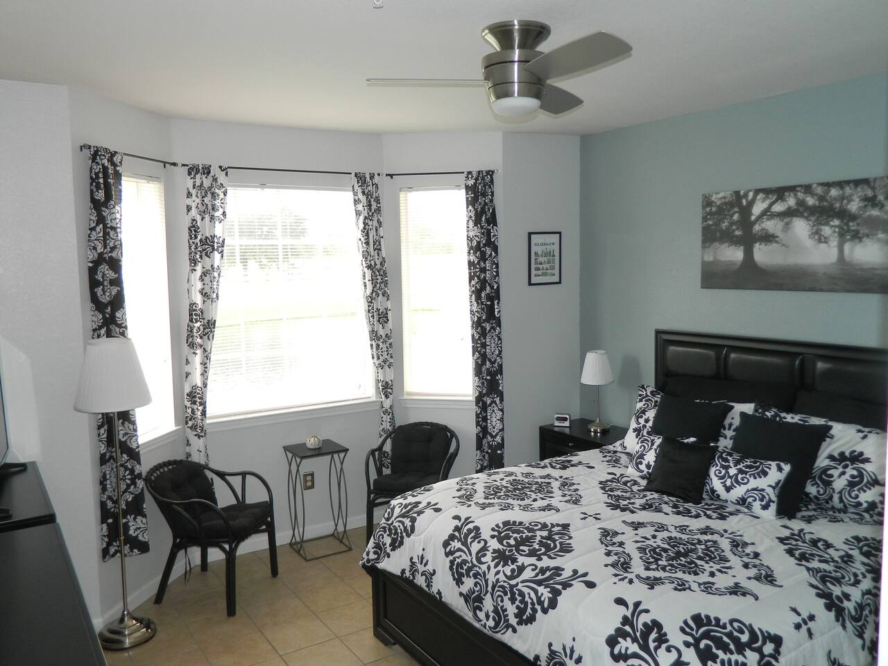 King size Master bedroom with seating and remote control fan