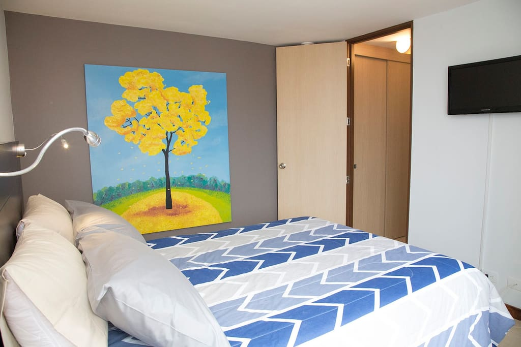Master Bedroom with Queen Bed and in-suite bathroom