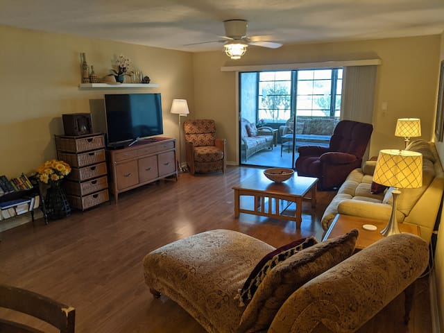 1st floor comfortable Living Room, cable TV with Roku,  opens to screened lanai with outdoor living room.