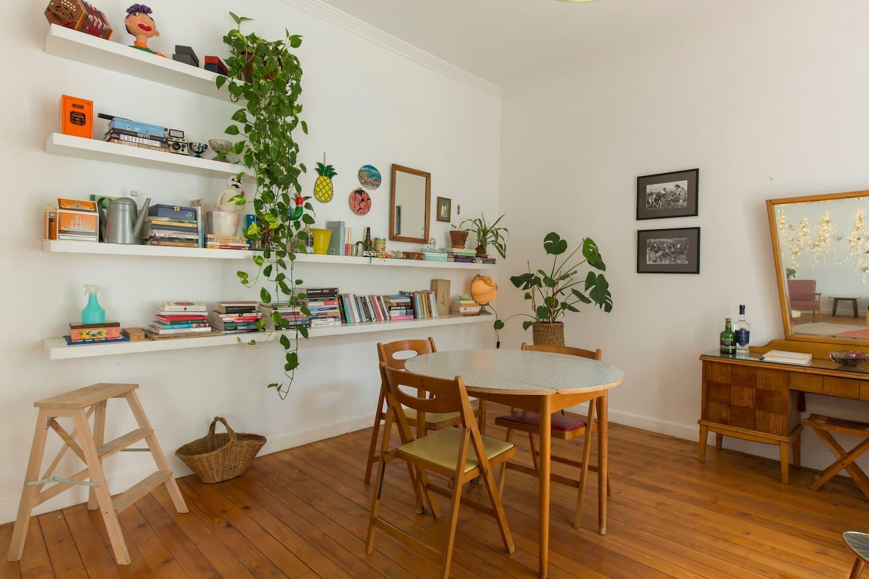 living room Mid-century furniture, plants, high ceilings and original floor boards