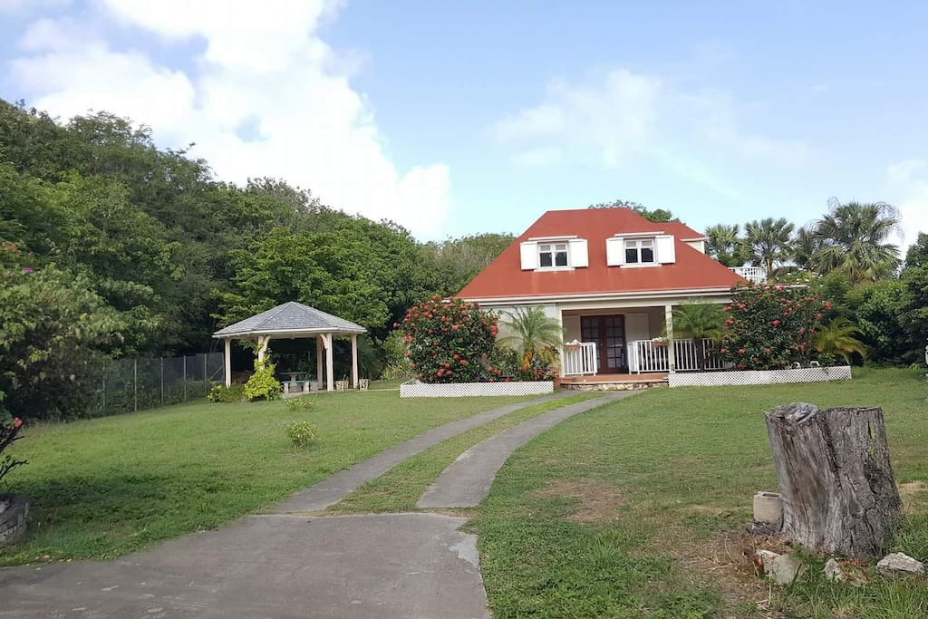 The property has a wide garden space and a cozy gazebo.
