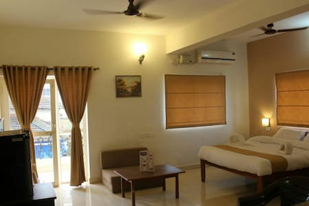 Studio room with a private sit-out - Candolim