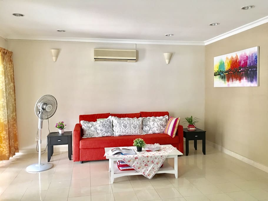 Air Conditioned living room with Unify, TV and Hypp TV , DVD player and dozens of DVD to entertain guests