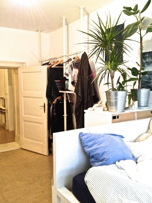 Bed and wardrobe in the background