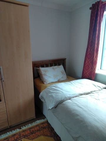 Two Single beds in large bedroom,