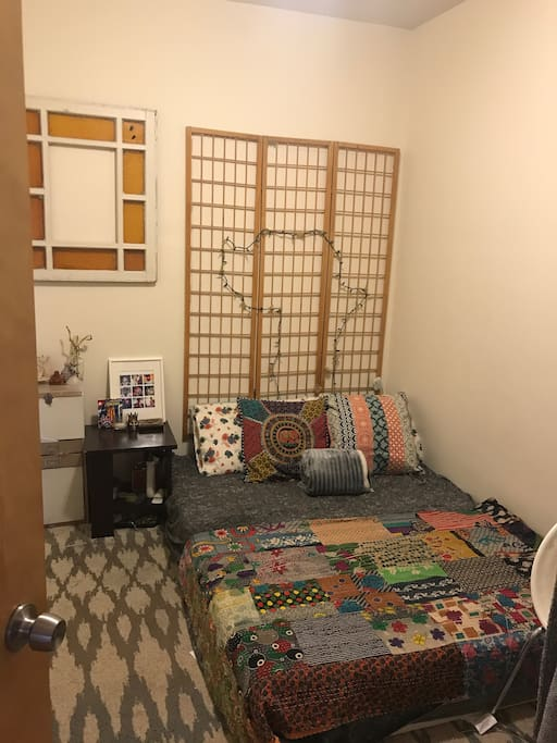 Comfy bedroom with an artistic flair