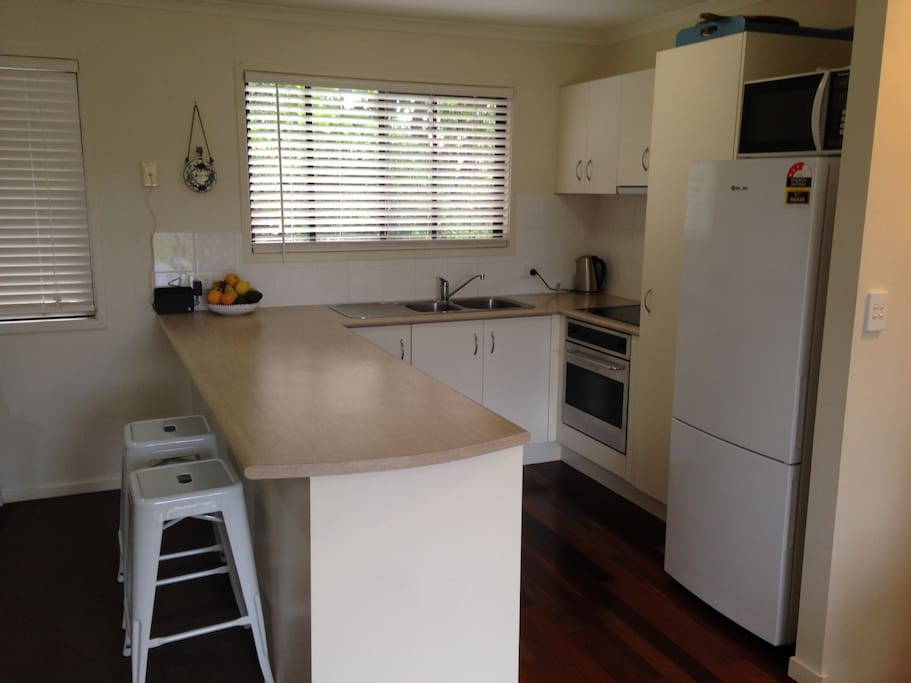 Kitchen has stove, oven, microwave, fridge. Other appliances include toaster, kettle, blender. All pots, pans, plates, glassware and cutlery available.