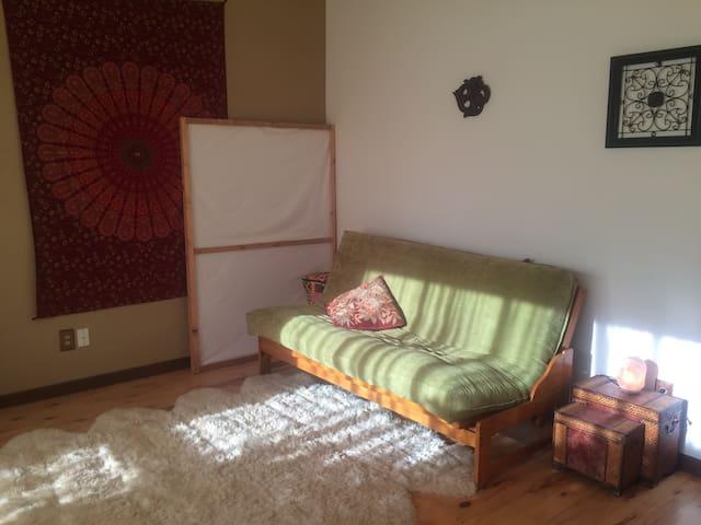 Comfy futon in a semi private living room space