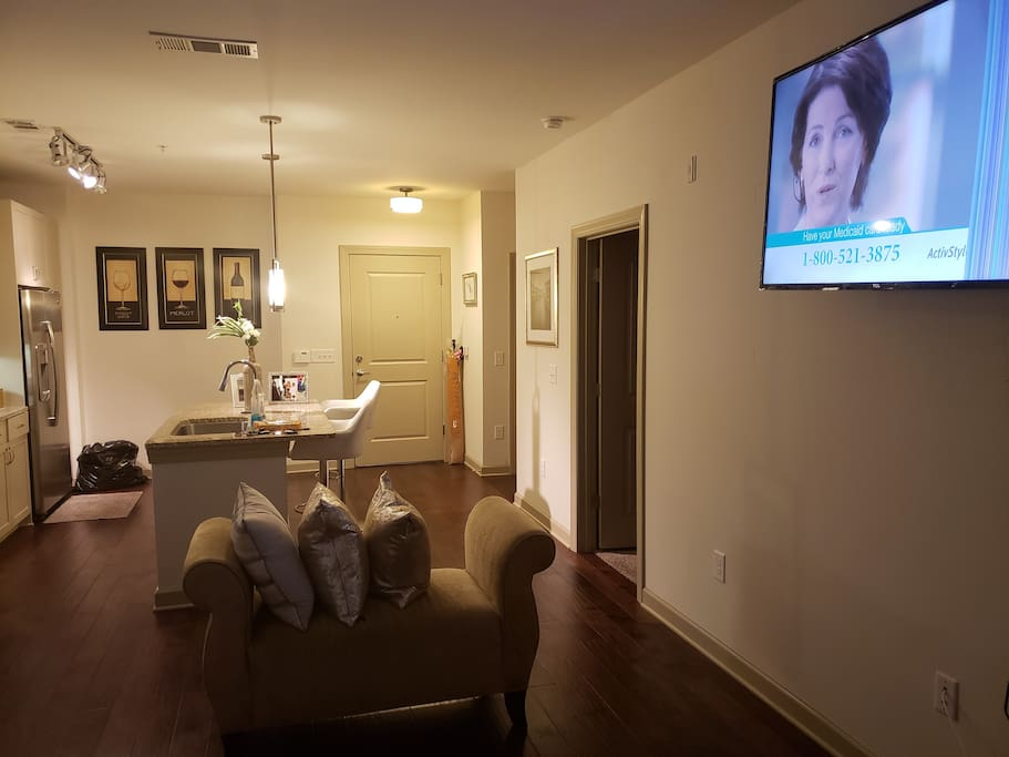 Spacious living room 60 inch television for a relaxing experience.