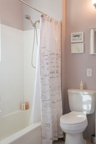 Enjoy a relaxing bath or shower at our compact but well equipped full bath. Hand soap, shampoo, conditioner, shower gel, and body lotion provided. Hairdryer and first aid kit are located behind the cabinet doors
