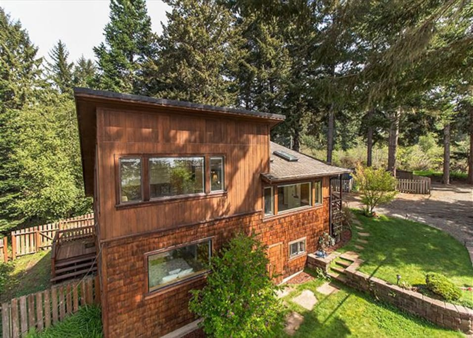 Scenic Cove is surrounded by Evergreens and well kept natural landscaping.