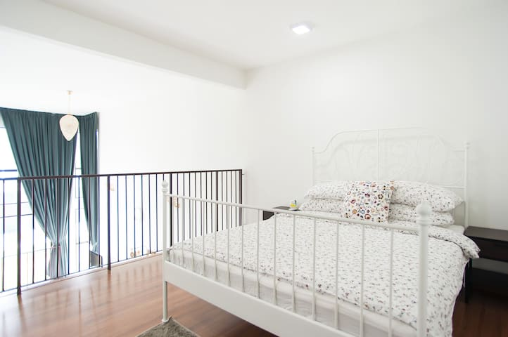 Queen bed space on the upper loft giving you privacy on studio space