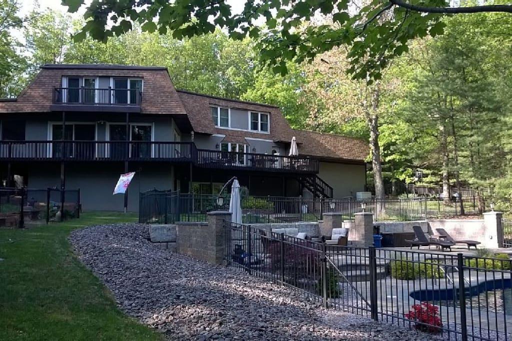 Wrap around deck and bedroom balconies