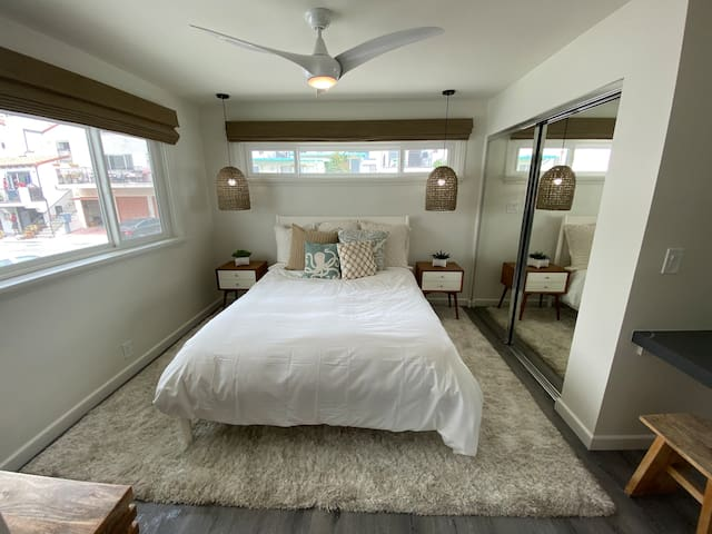Our bedroom features a cozy, cloud-like queen bed with a desk,  dresser & closet.  The lights and fan are three way so you never have to get out of bed to turn them off :)