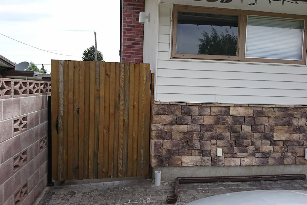 Left side gate into back yard.