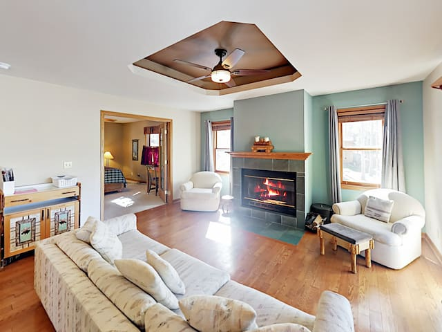 Enjoy the warm ambience of the wood-burning fireplace in welcoming living room.