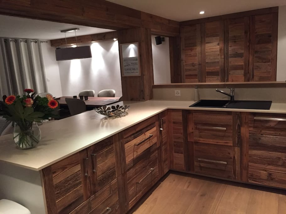 """Wonderful, very large, fully fitted kitchen. The large """"island"""" has 4 stools and is perfect for breakfast or cocktails. Modern, easy to clean surfaces with aged wood panels"""