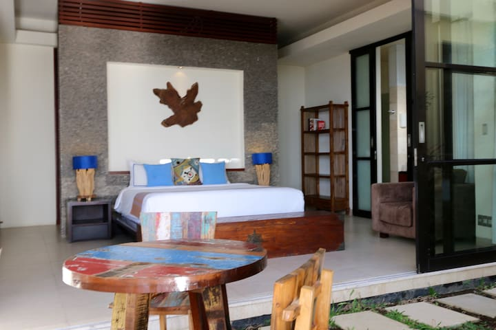 Bedroom No.2 with breakfast table on the terrace outside the room