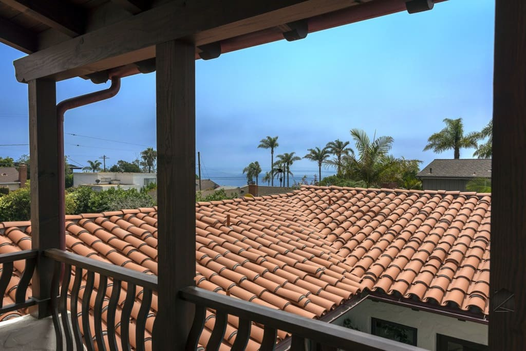 Out on the master balcony and just beyond your Mission-style roof, the Pacific is calling your name