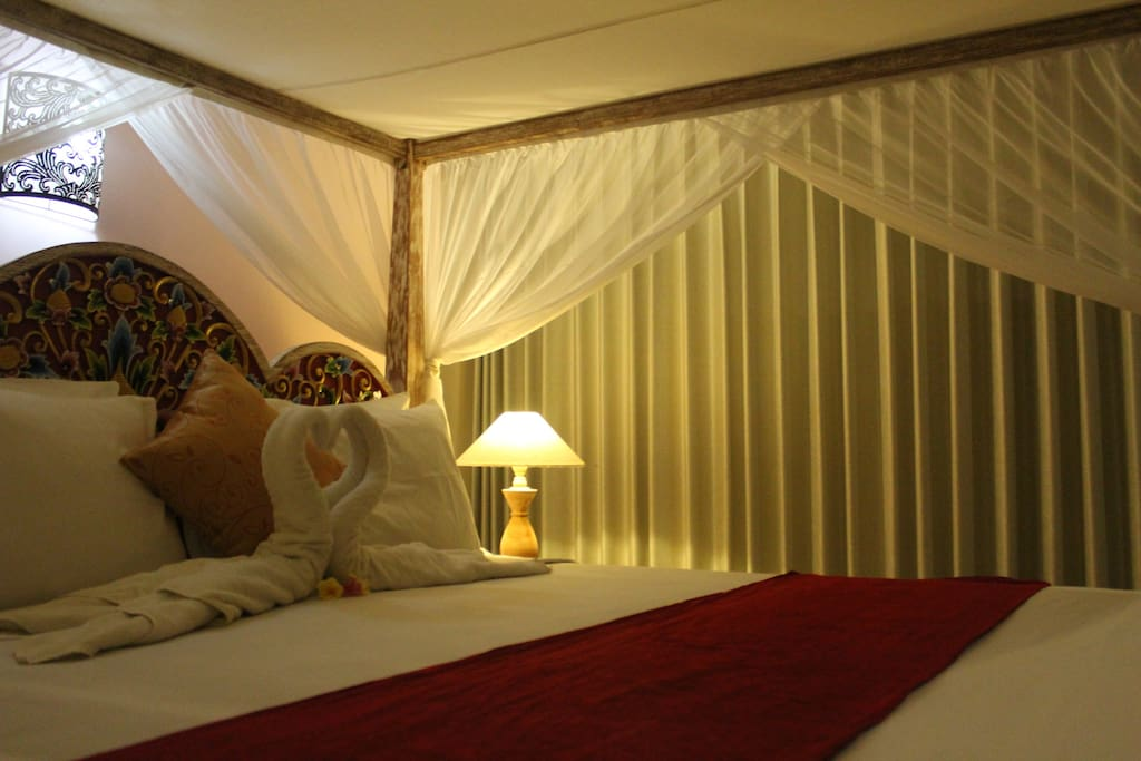 view inside the room with king size bed.
