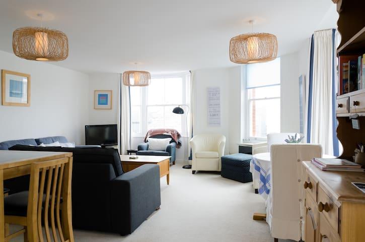 A beautiful bright room with big bay windows