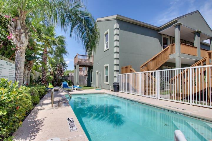 Dog-friendly modern condo near beach access - ocean views & shared pool!