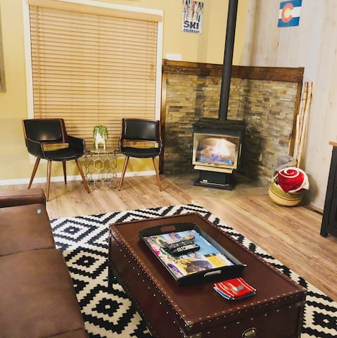 Plenty of seating. 4 chairs and a large leather sofa that is comfortable to sleep on if you end up with more than 4 guests! We have a sleeping pad that can be laid on the floor and is also comfortable! We love sitting in front of the fire.