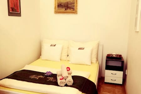 City center, a clean and cozy room.