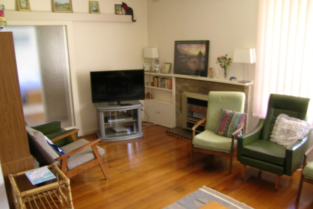 Living/TV area. Plenty of seating and great for relaxing.  New flat screen TV now provided.  DVD player also provided.