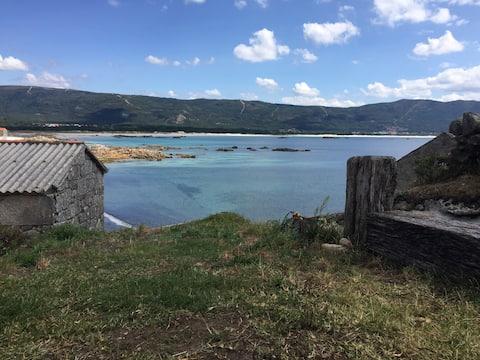 Fiskarnas hus i hjärtat av Playa de Carnota