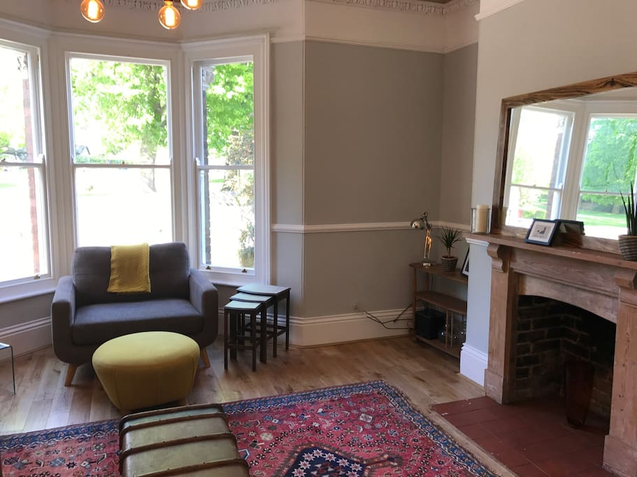 Living room with large bay window and overlooking the park.