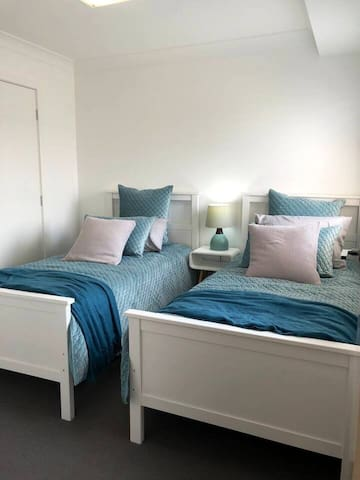 Bedroom with two single beds and built in wardrobe