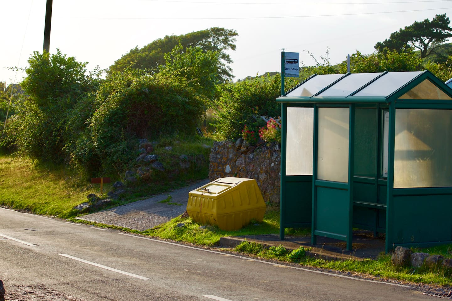 This is the entrance to our AirB&B...a yellow road grit bin and the only bus shelter in the village and when you look u the drive you will see our home ....in the next photo and again as a reference we are the 4th house down the hill .