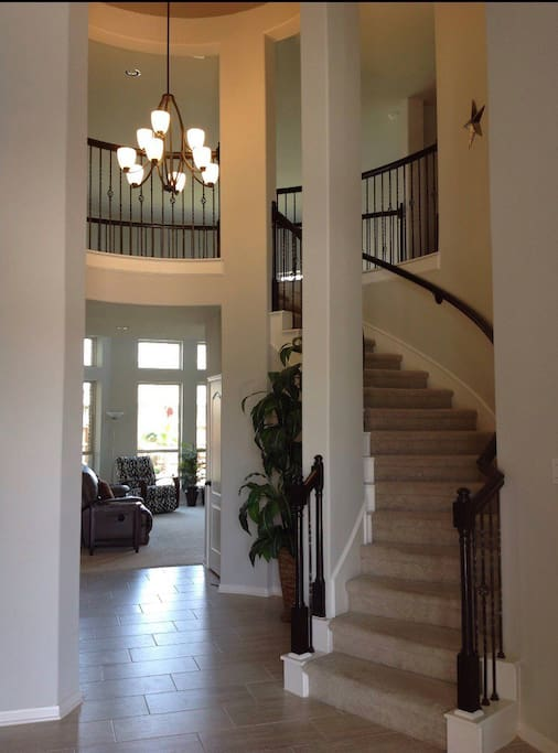 Grand entry/stairs leading to guest room