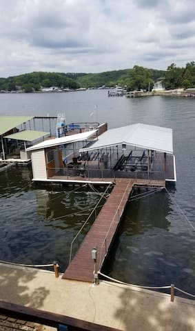 View of dock and concrete martini deck from house