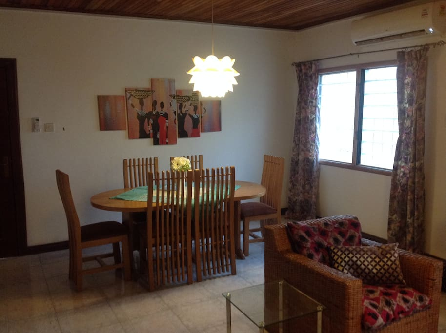Dining area, Hall 2, with 6 seater dining set, wall painting, entertainment system, AC, etc.