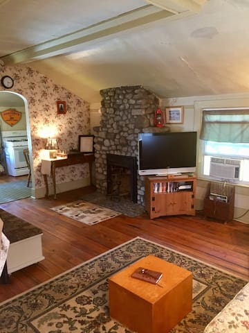 Additional view of the television and arched entry into the kitchen area.