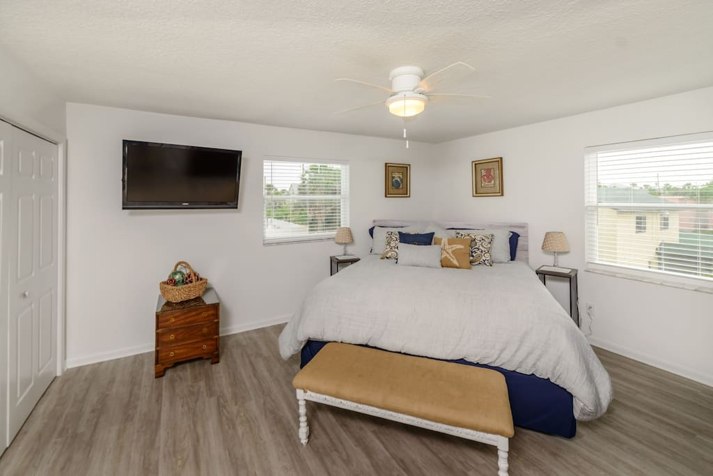 Master Bedroom with King Sized Bed and Large TV