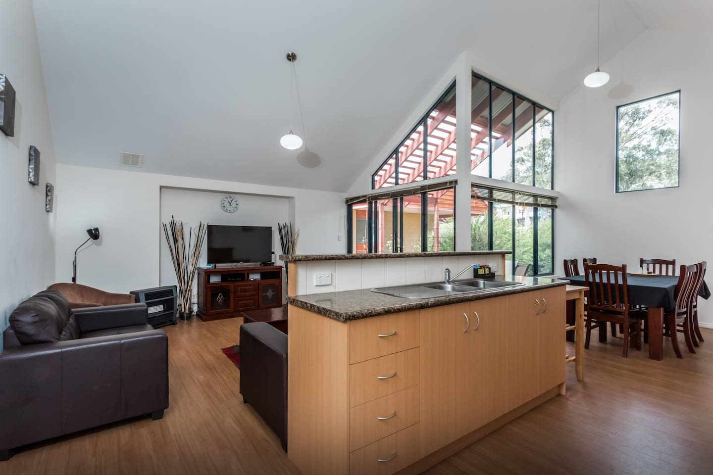 Open plan living and dining space, including: • Fully equipped kitchen; • Alfresco (outside) and inside dining;  • Flat screen TV;  • Sofa seating, comfortably seats 6; • Large windows, high ceilings, beautiful natural light; • Native garden views.