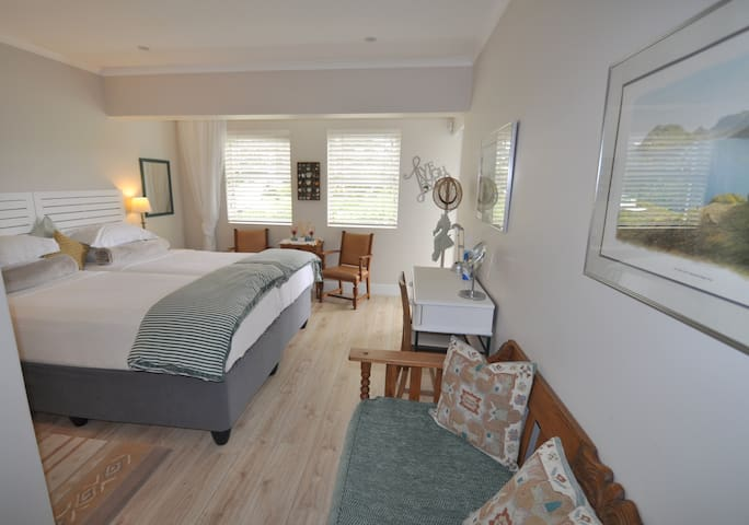 The unit has a desk and a day-bed in the spacious bedroom.