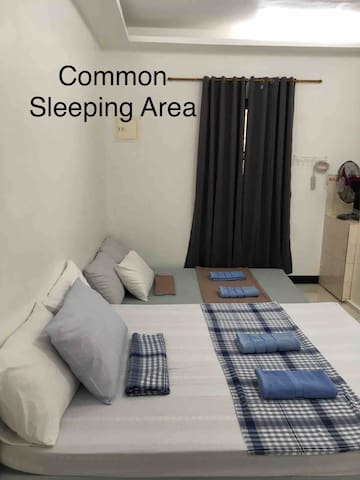 Common sleeping area with queen size bed plus  1 queen size mattress.