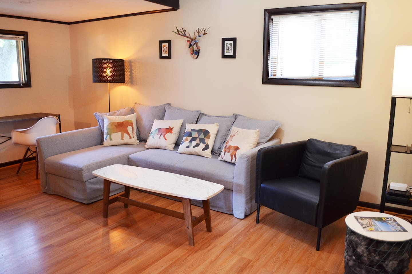 Stay at our vintage home with a modern flare in the perfect neighborhood for a relaxing week in beautiful Manistee.  Living room couch converts to a queen-sized bed with no bar.