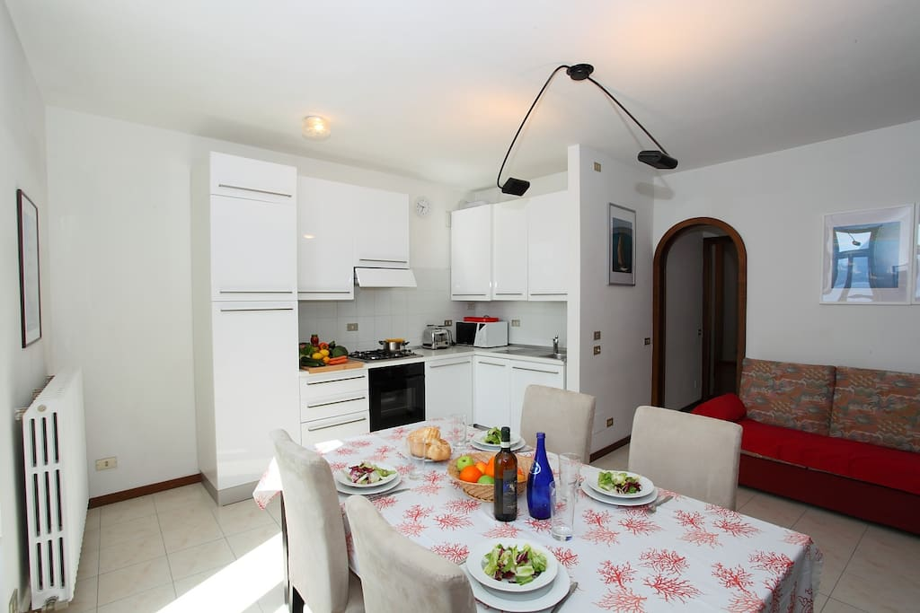 Fully equipped kitchen, dining area and double sofa bed