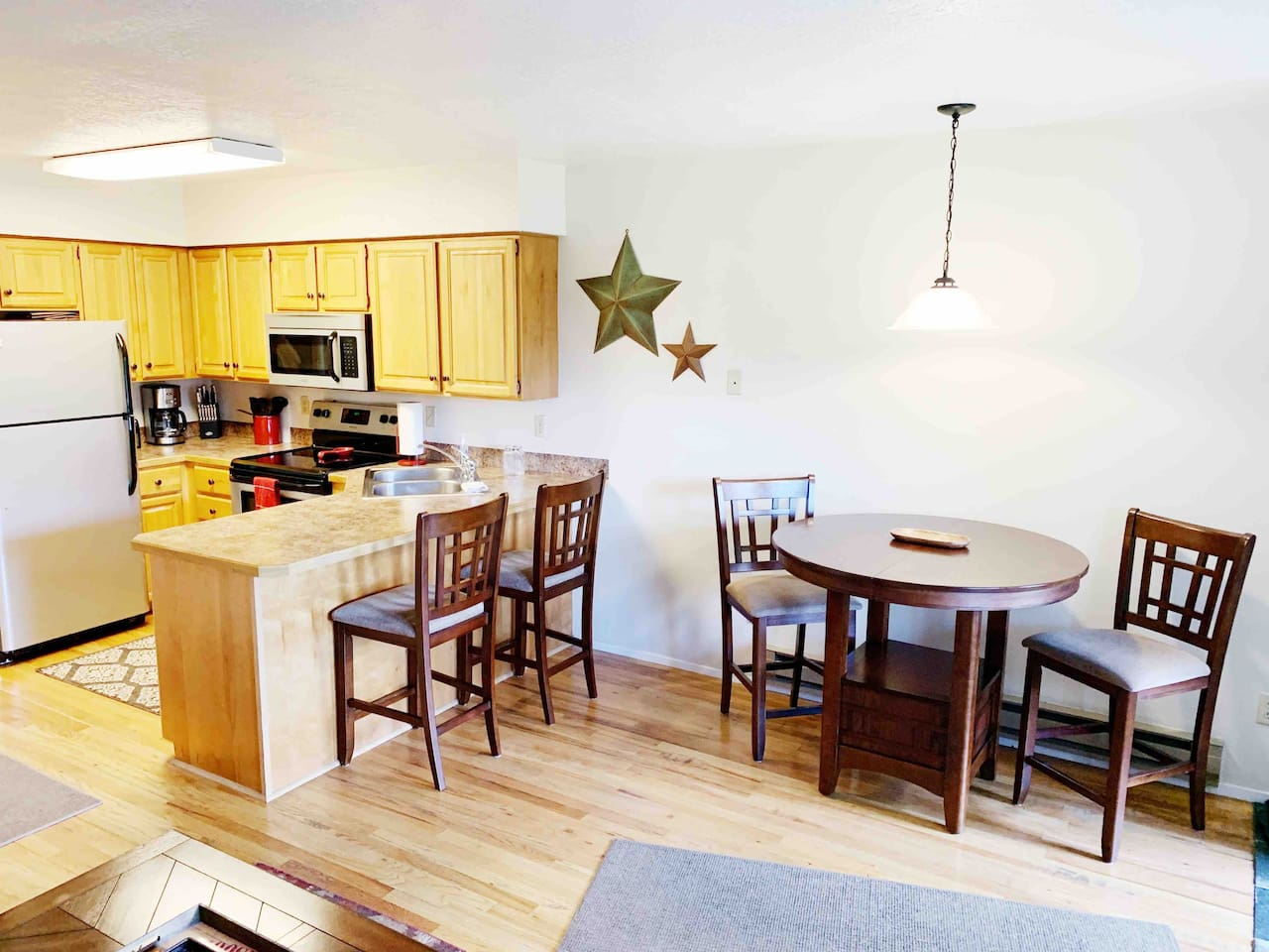 Fully stocked kitchen with stainless steal appliances. Seating for four.