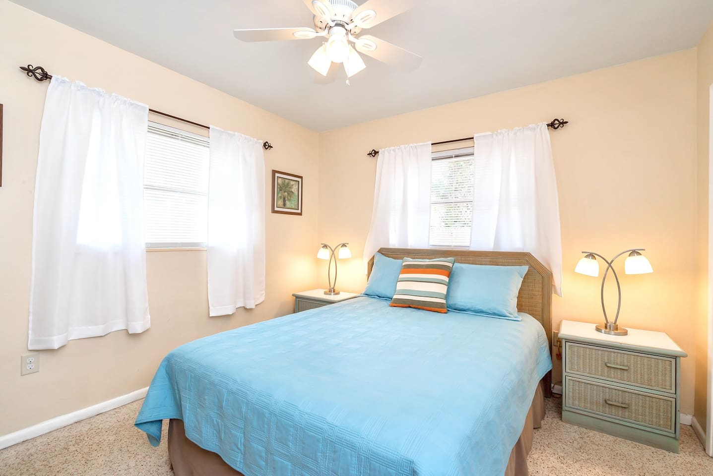Master bedroom with ceiling fan and Roku TV