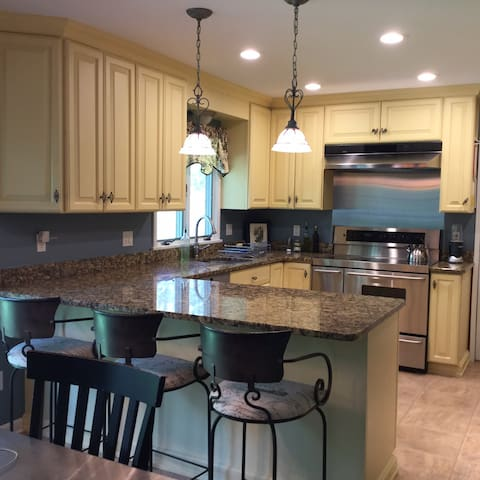 Kitchen with 3 bar seats plus eat-in kitchen.  Fully stocked kitchen supplies.