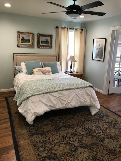 Lush queen bed with designer linens