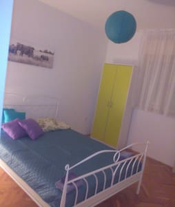 This is a new bedroom with a new double bed in a large flat. There are 2 bathrooms, Wifi...young host :) :) Living room and kitchen are sharing,  I provide for my guests coffee, tea, milk, cappuccino, fruit, cereals, eggs, bread....